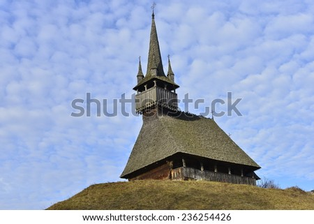The wooden church from Paniceni, Romania, Europe/Wooden church on top of hill/ Wooden church and blue sky - stock photo