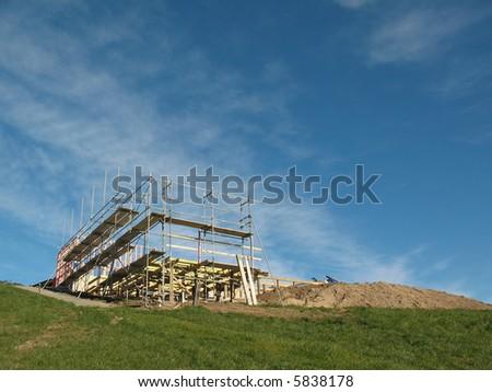 The wooden framework of a new hillside home - stock photo