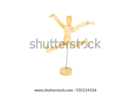 The wooden mannequin jumps with the hands lifted upwards isolated on white background