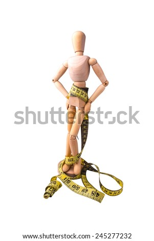 The wooden model of the person symbolizing a healthy slim figure with a measured tape round a waist - stock photo