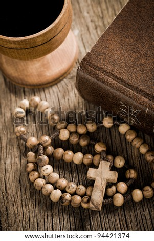 the wooden rosary and the Bible - stock photo