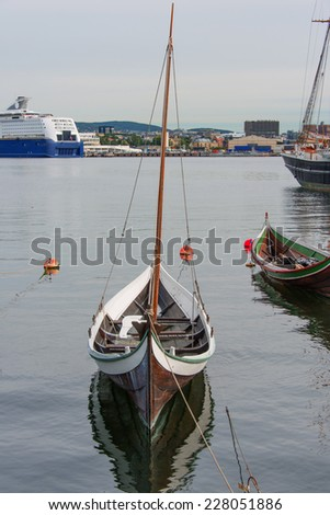 The wooden rowing and sailing boat - stock photo