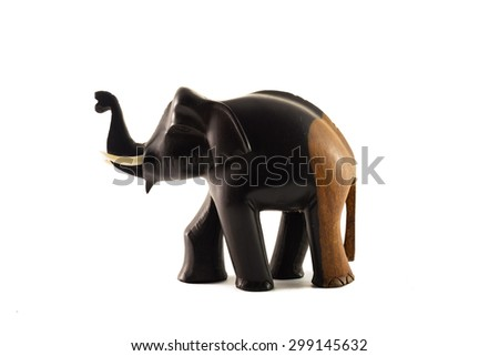 The wooden statue of the elephant black and brown on a white background - stock photo