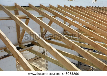 Wooden structure building wooden frame building stock for Roof trusses installation