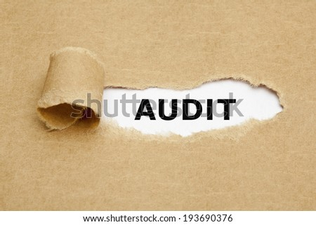 The word Audit appearing behind torn brown paper. - stock photo