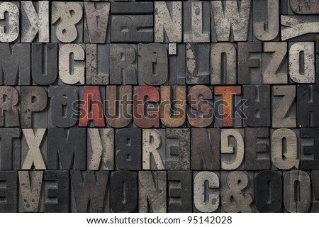 The word August written in antique letterpress printing blocks. - stock photo