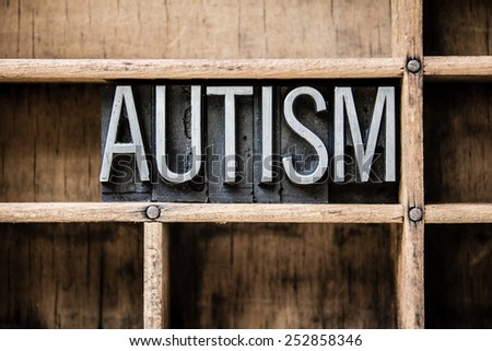 "The word ""AUTISM"" written in vintage metal letterpress type sitting in a wooden drawer. - stock photo"