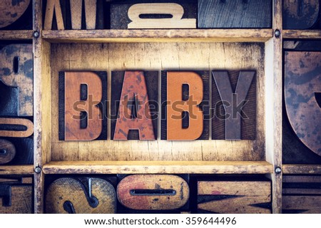 "The word ""Baby"" written in vintage wooden letterpress type."