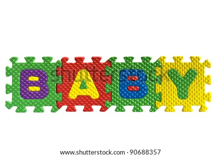 """The word """"Baby"""" written with alphabet puzzle letters isolated on white background - stock photo"""