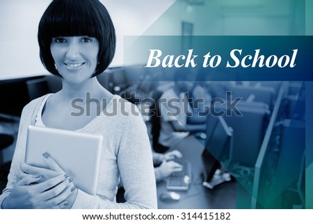 The word back to school against teacher with tablet pc - stock photo