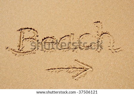 "The word ""beach"" written in the sand"