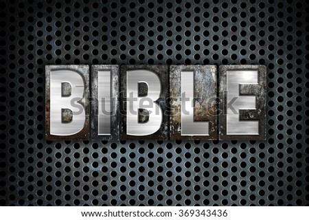 """The word """"Bible"""" written in vintage metal letterpress type on a black industrial grid background. - stock photo"""