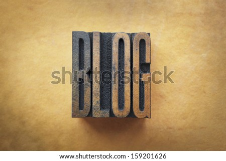 The word BLOG written in vintage letterpress type. - stock photo