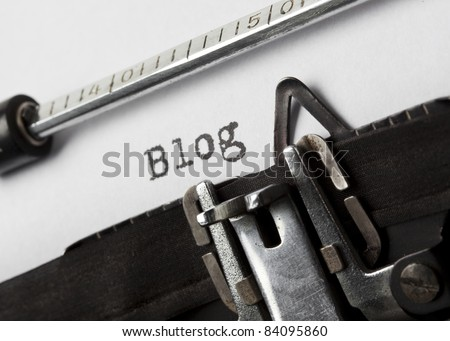 the word blog written with old typewriter, tilted view - stock photo