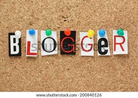 The word Blogger in cut out magazine letters pinned to a cork notice board
