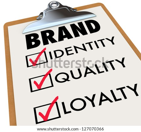 The word brand and its core characteristics such as Identity, Quality and Loyalty written on a checklist on a clipboard to illustrate what you need to do to build your reputation among customers - stock photo