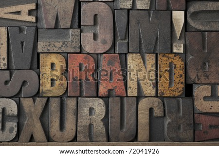 The word 'BRAND' written out in old letterpress printing blocks - stock photo