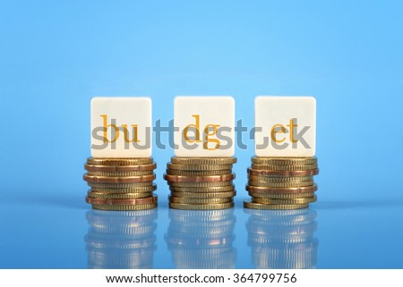 The word Budget on stacked coins, finance conceptual - stock photo