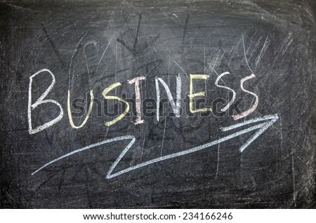 "The word ""BUSINESS"" written on blackboard  - stock photo"