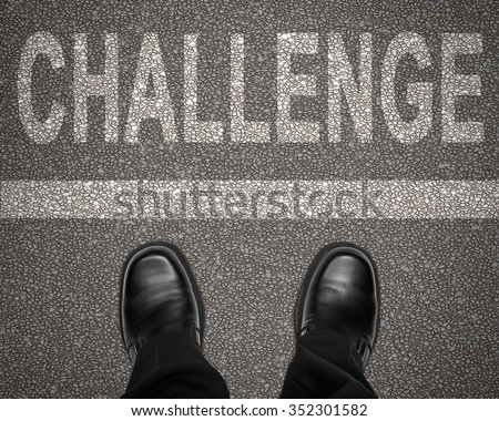 The word challenge with line on road and business man shoes standing still, top view, looking down - stock photo