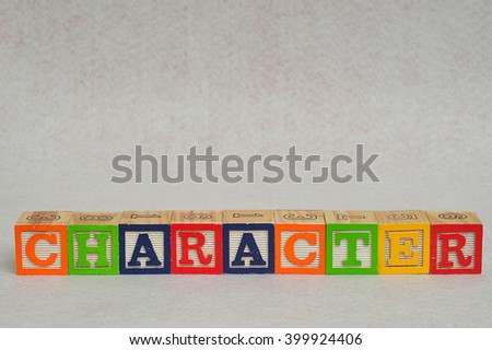 The word character spelled with colorful alphabet blocks isolated on white background