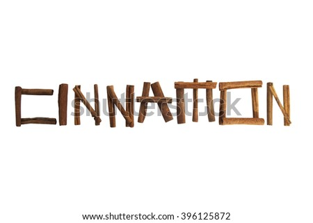 The word cinnamon with sticks isolated over white - stock photo