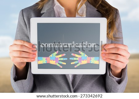 The word communication and businesswoman showing a tablet pc against medical background with blue ecg line - stock photo