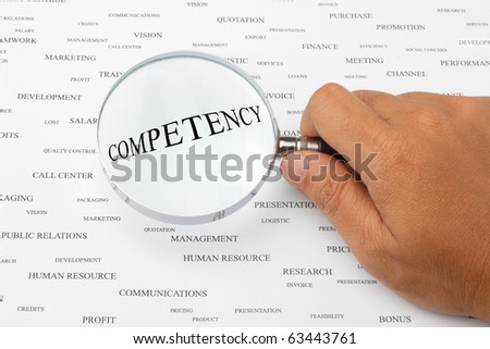 The word COMPETENCY is magnified.