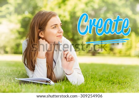 The word create against smiling university student lying and thinking - stock photo