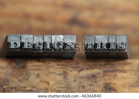 the word design this in letterpress type on a wooden background. - stock photo