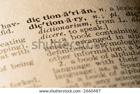 The word dictionary. Close-up of the word dictionary and its definition. - stock photo