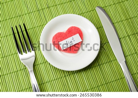 "The word ""diet"" and the symbol of the heart lie on a small saucer and denote sympathy to the diet - stock photo"