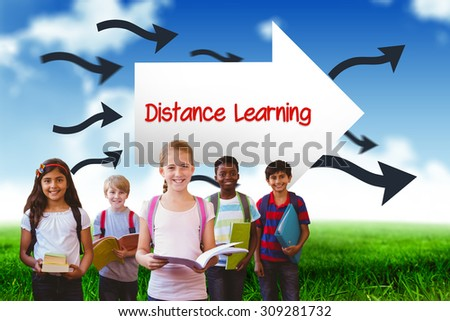 The word distance learning and smiling little school kids in school corridor against blue sky over green field - stock photo