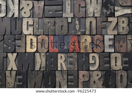 The word Dollars written in antique letterpress printing blocks. - stock photo