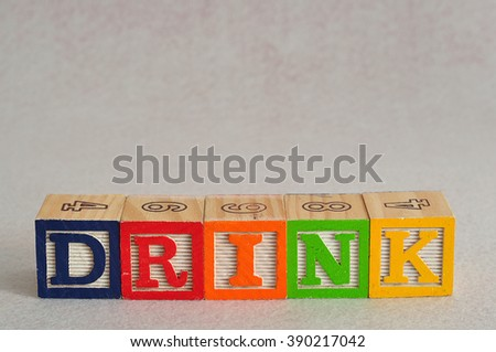 The word drink spelled with alphabet blocks isolated on a white background - stock photo