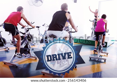 The word drive and spin class working out with motivational instructor against badge - stock photo