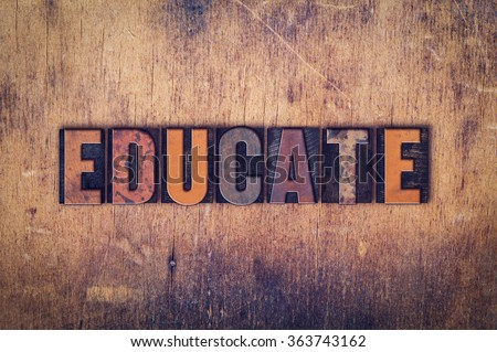 """The word """"Educate"""" written in dirty vintage letterpress type on a aged wooden background. - stock photo"""