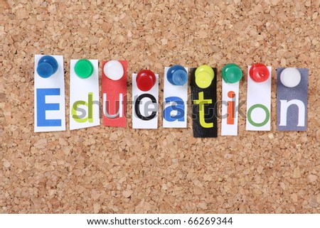 The word Education in cut out magazine letters pinned to a cork notice board