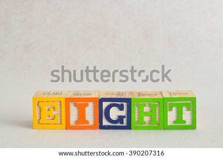 The word eight (8) spelled with colorful alphabet blocks isolated against a white background - stock photo