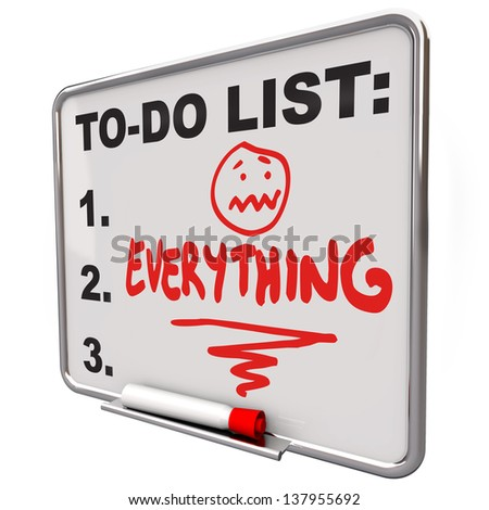 The word Everything on a To-Do list on a dry erase board to remind you of your tasks, priorities, goals and objectives - stock photo