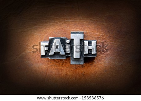 The word faith made from vintage lead letterpress type on a leather background. - stock photo