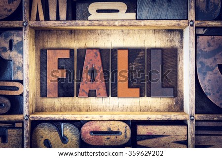 "The word ""Fall"" written in vintage wooden letterpress type."