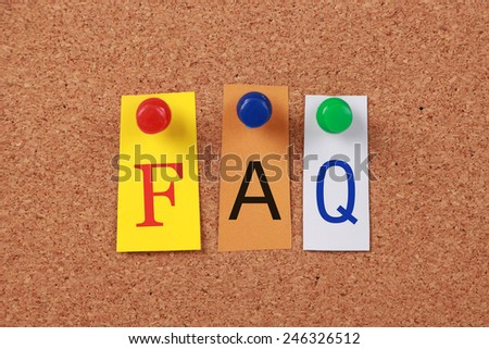 The word FAQ in cut out magazine letters pinned to a cork board. - stock photo