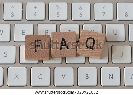 The Word FAQ on Wooden Cubes - stock photo