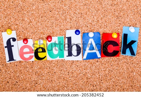 The word Feedback in cut out magazine letters pinned to a cork notice board - stock photo