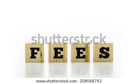 The word - Fees - on four natural wooden blocks or cubes on a reflective white surface with copyspace above in a conceptual financial image. - stock photo