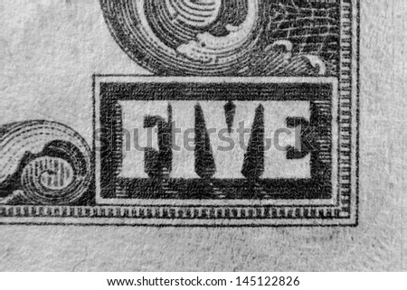 The word five on US currency 5 dollar bill - stock photo