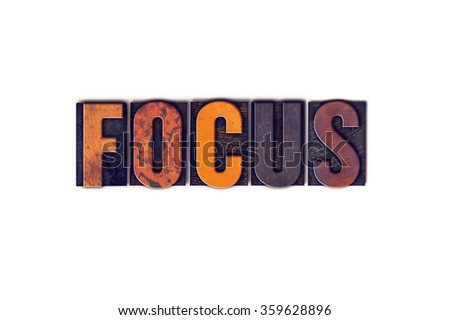 """The word """"Focus"""" written in isolated vintage wooden letterpress type on a white background. - stock photo"""