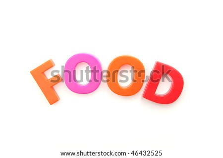 The word 'food' spelled out using colored fridge magnets, isolated on white