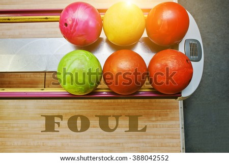 The word foul background bowling balls